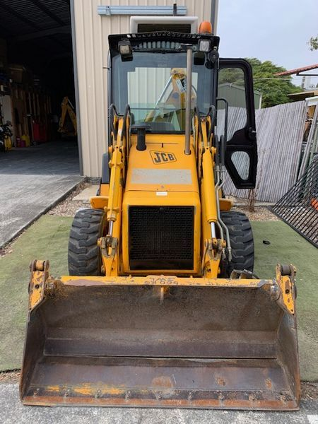 Under Auction - 2007, JCB 1CX Skidsteer Backhoe Loader, with 4in1 Front Quickhitch Bucket - 2% + GST Buyers Premium On All Lots