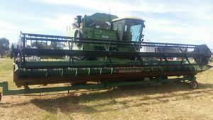 **PRICE NEGOTIABLE** John Deere 8820 Header with Front & Trailer