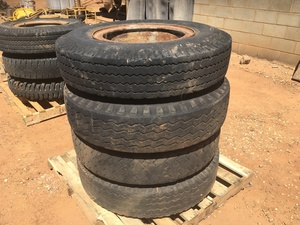 Under Auction - (A132) - 4 x 20 inch Split Rim Tyres 900 - 2% + GST Buyers Premium On All Lots
