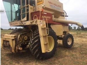 New Holland TR85 Header Harvester (In working Condition) + one available for parts (front & trailer included)