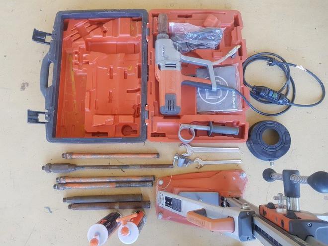 Husqvarna DM230 Diamond Drill Kit with assortment of bits