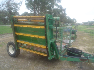 Under Auction - (A141) - Elsworth Big Square and Round Bale Feedout Machine - 2% + GST Buyers Premium On All Lots